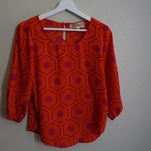 Orange and pink patterned blouse